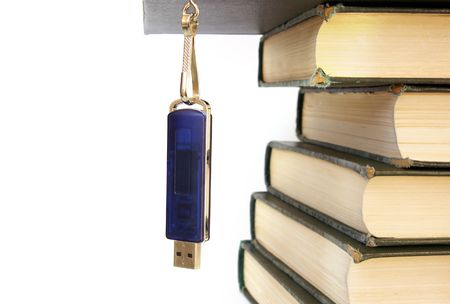 Books stack and flash memory isolated on white photo