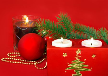 Christmas card. Candle and decoration isolated on red photo