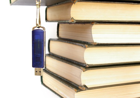 Books stack and flash memory isolated on white Stock Photo - 4009928