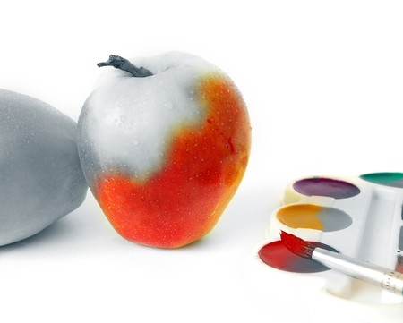 Apple and paints isolated on white background photo