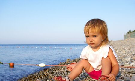 seacoast: Cute little girl on a seacoast. Beautyful weather