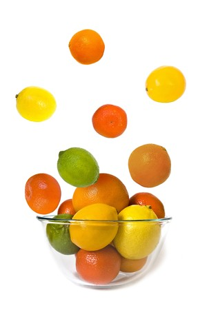 Bowl of citrus fruits on white background Stock Photo - 4151610