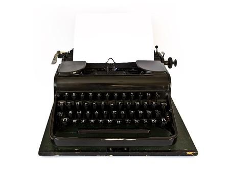 Old black typewriter isolated on white background photo