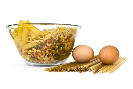 Colorful noodles and two eggs on white photo