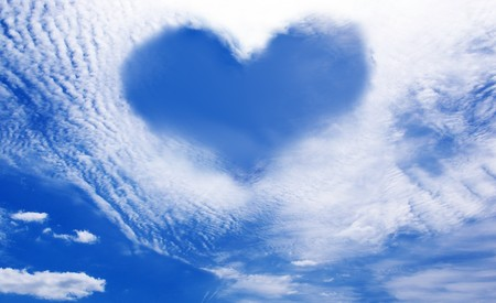 clouds making: White clouds making a heart shape againt a blue sky