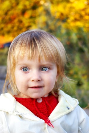 babie: Cute little girl and yellow autumnal leaf Stock Photo