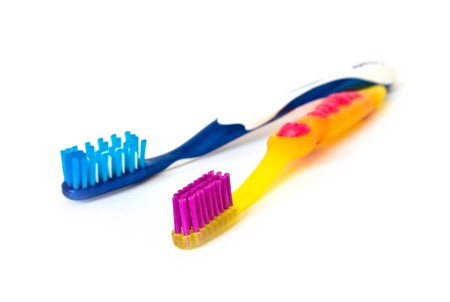 dichromatic: Bicolor toothbrushs isolated on a white background Stock Photo