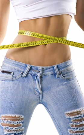 Woman measuring her small waist isolated on white
