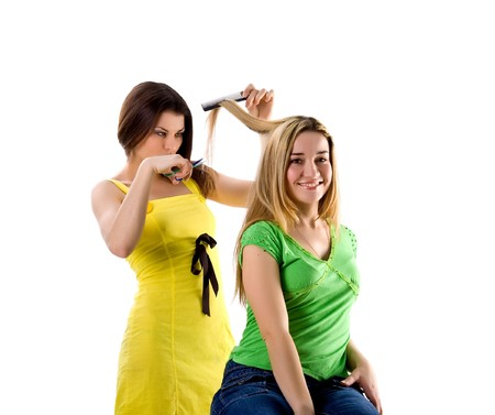 Hairdresser and her client on white background photo