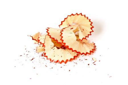 Red pencil shavings on white paper background photo