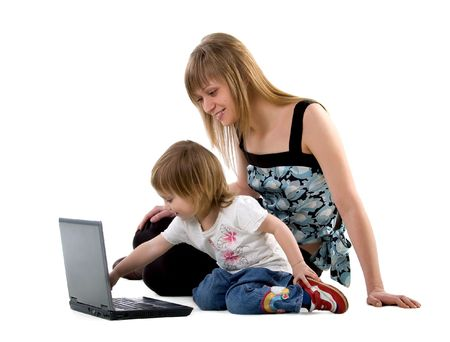 Little girl and her mother sits near laptop photo