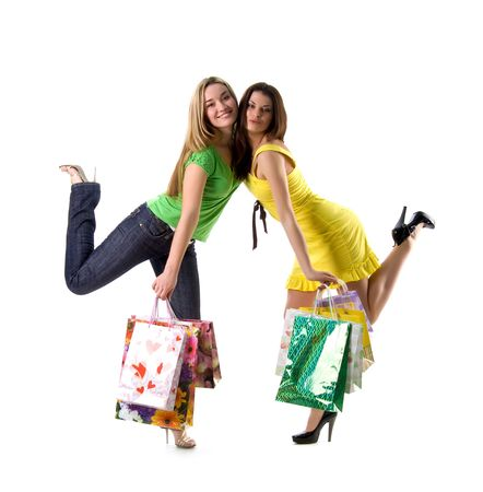 Two pretty women and bags on white background photo