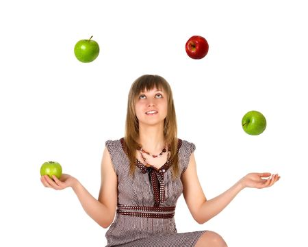 Woman juggling with apples. Isolated on white background photo