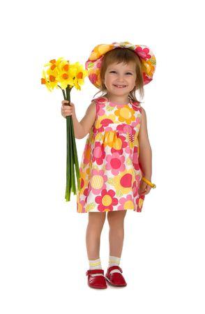 Cute little girl giving flowers. Studio shot