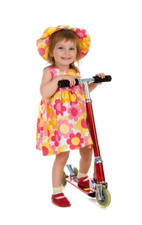 Little girl and her scooter. Studio isolated photo