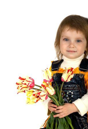 Cute little girl giving tulips. Studio shot photo