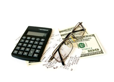 Calculator, checks and dollars on white background photo