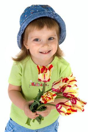 Cute little girl giving tulips. Studio shot Stock Photo