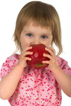 Little girl with red apple isolated on white background photo