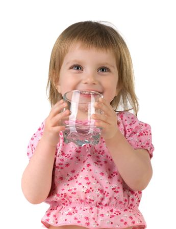 drinking glass: Little girl drink the water. Isolated on white