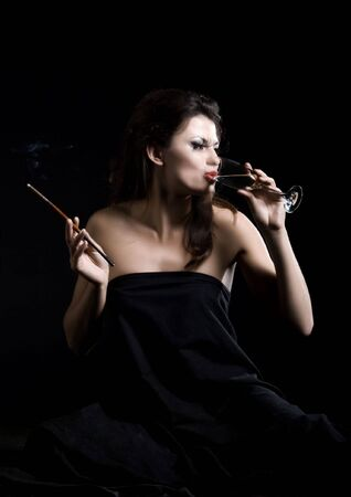 glamor women with champagne and cigarette on black photo