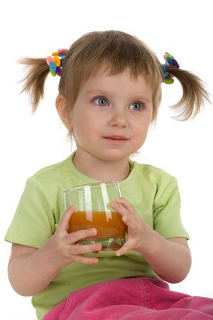 Cute little girl drink carrot juice. White background Stock Photo - 5129744