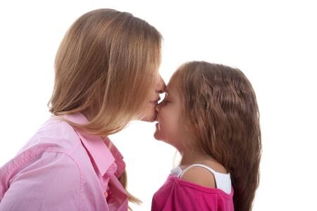 Cute little girl and her mother. Studio shot photo