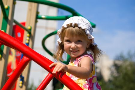 jungle gyms: Cute little girl on outdoor playground equipment