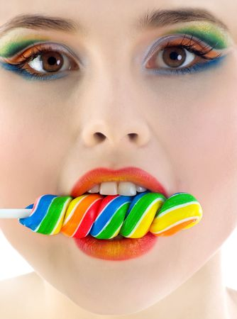 Cute woman with bright candy close-up. Studio shot photo