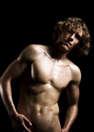 Beautyful nude man on a black background
