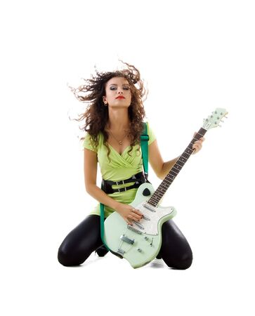 Cute women with electric guitar. Studio isolated photo