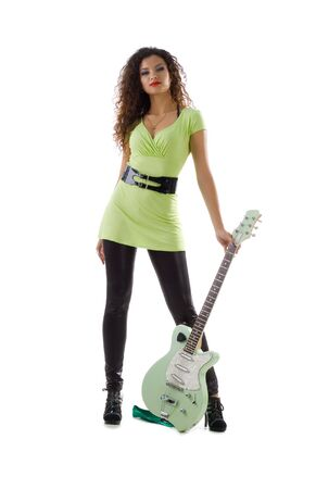 Pretty women with electric guitar. Studio isolated photo