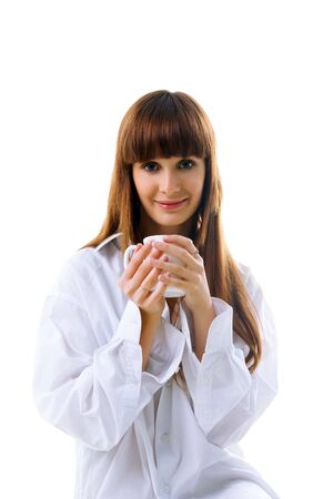 Cute woman with cup of tea on white background photo