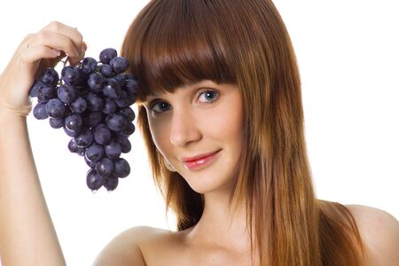Cute women with a grapes on a white background photo