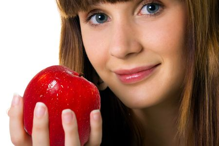 Cute women with red apple on a white background photo