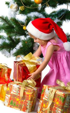 Cute xmas girl wihts gifts. Isolated on wite