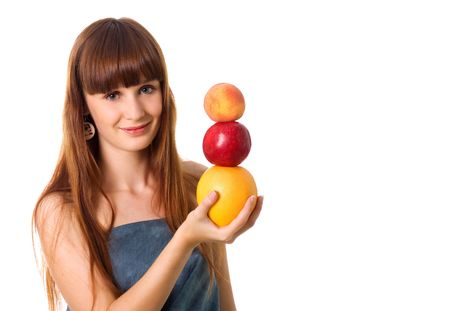 Pretty woman hold some fruits. Studio shot Stock Photo - 5544983