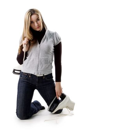 Beautiful young woman and skates on white photo