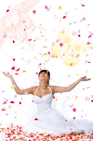 Cute bride throws rose petals. White background photo
