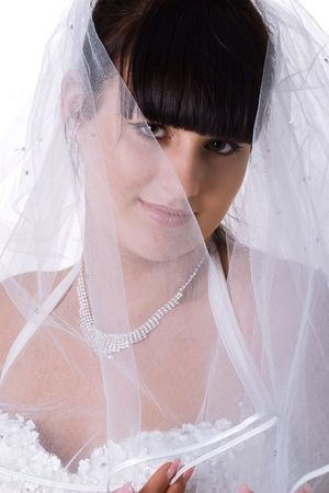 Pretty bride in a white dress. Studio shot photo