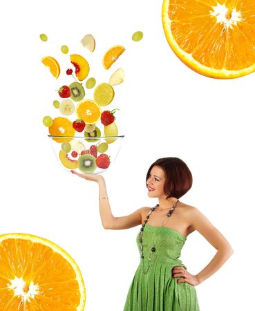 Beautiful young woman with a fruit salad on white background Stock Photo - 5619582