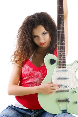 Cute women in red with electric guitar. Studio isolated photo