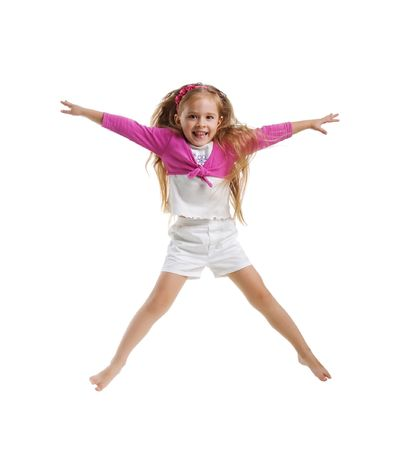 girl in shorts: Cute little girl jump. Studio shot. White background Stock Photo