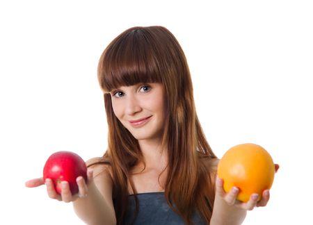 Pretty woman hold apple and orange. Studio shot photo