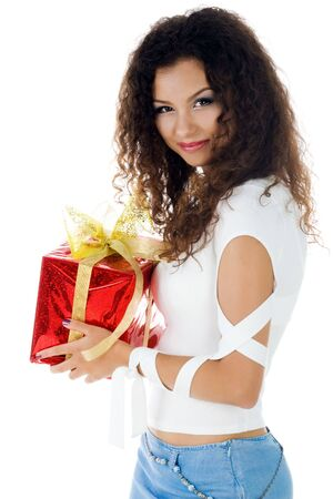 Pretty woman with a christmas gift. Studio isolated photo