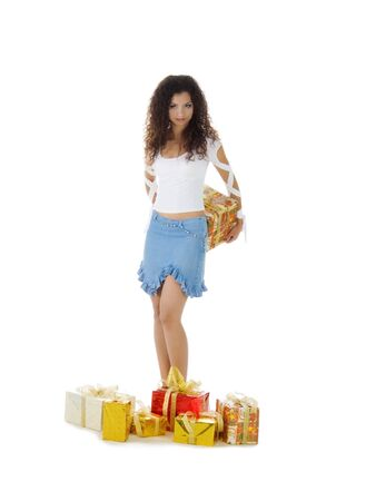 Pretty woman with a christmas gift behind the back. Studio isolated photo
