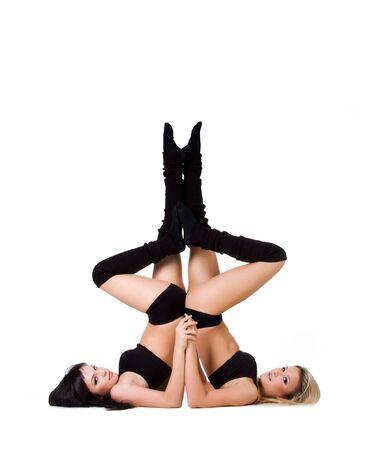 nude lesbian: Modern ballet dancer posing over white background