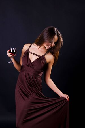 Glamour women with the whine on black background photo