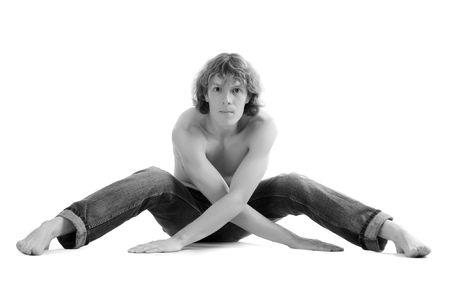 Pretty man sit on the floor. White background photo