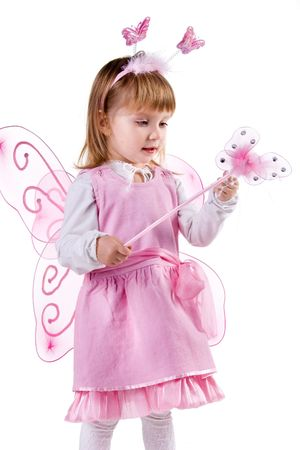 Little girl in fairy costume on white background photo
